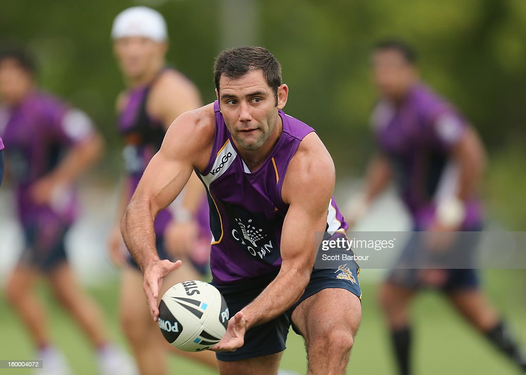 <a gi-track='captionPersonalityLinkClicked' href=/galleries/search?phrase=Cameron+Smith+-+Rugby+League+Player&family=editorial&specificpeople=453295 ng-click='$event.stopPropagation()'>Cameron Smith</a> of the Storm passes the ball during a Melbourne Storm NRL training session at Gosch's Paddock on January 25, 2013 in Melbourne, Australia.