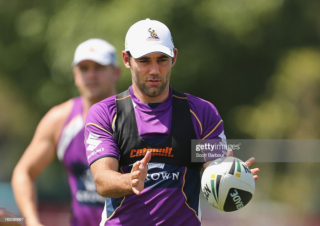 Cameron Smith of the Storm passes the ball during a Melbourne Storm NRL training session at Gosch's Paddock on March 7, 2013 in Melbourne, Australia.