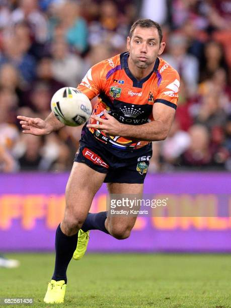Cameron Smith of the Storm passes the ball during the round 10 NRL match between the Melbourne Storm and the Gold Coast Titans at Suncorp Stadium on...