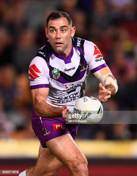 Cameron Smith of the Storm passes the ball during the round 22 NRL match between the North Queensland Cowboys and the Melbourne Storm at 1300SMILES...