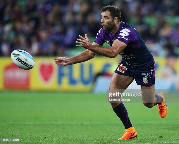 Cameron Smith of the Storm passes the ball during the round five NRL match between the Melbourne Storm and the New Zealand Warriors at AAMI Park on...