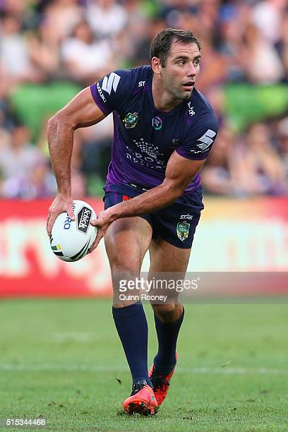 Cameron Smith of the Storm passes the ball during the round two NRL match between the Melbourne Storm and the Gold Coast Titans at AAMI Park on March...