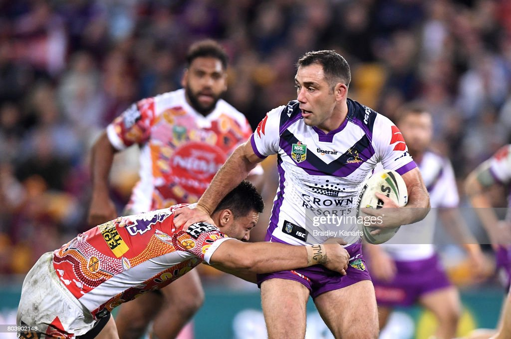 Cameron Smith of the Storm pushes away from the defence during the round 17 NRL match between the Brisbane Broncos and the Melbourne Storm at Suncorp Stadium on June 30, 2017 in Brisbane, Australia.