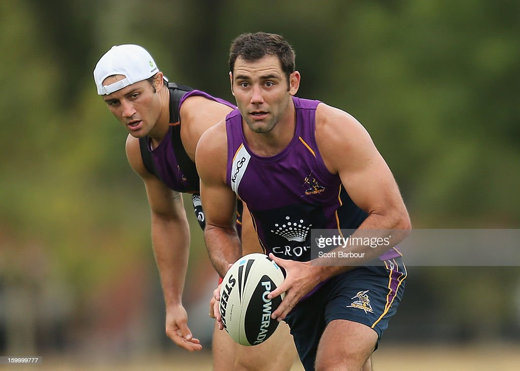 <a gi-track='captionPersonalityLinkClicked' href=/galleries/search?phrase=Cameron+Smith+-+Rugby+League+Player&family=editorial&specificpeople=453295 ng-click='$event.stopPropagation()'>Cameron Smith</a> of the Storm runs with the ball as <a gi-track='captionPersonalityLinkClicked' href=/galleries/search?phrase=Cooper+Cronk&family=editorial&specificpeople=234620 ng-click='$event.stopPropagation()'>Cooper Cronk</a> looks on during a Melbourne Storm NRL training session at Gosch's Paddock on January 25, 2013 in Melbourne, Australia.