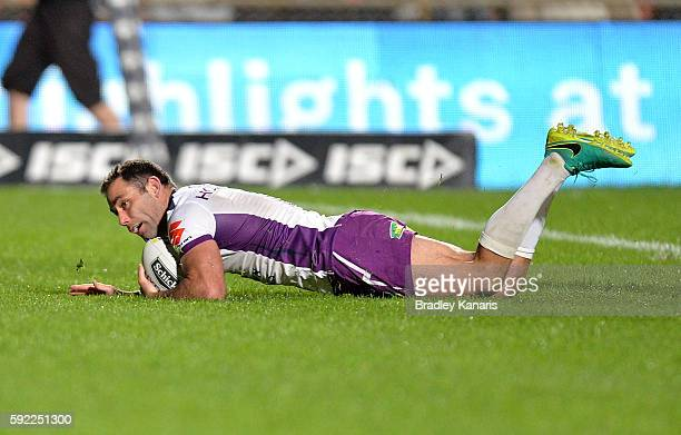 Cameron Smith of the Storm scores a try during the round 24 NRL match between the Manly Sea Eagles and the Melbourne Storm at Brookvale Oval on...