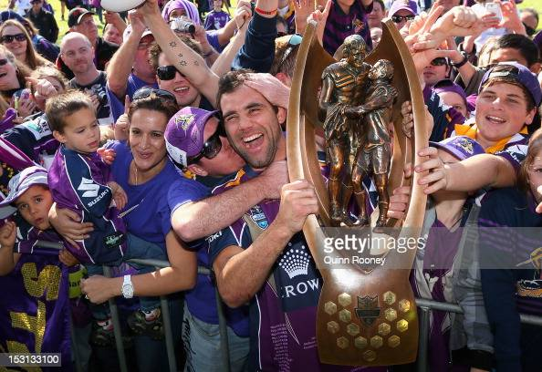 Cameron Smith of the Storm shows the trophy to the crowd during the Melbourne Storm NRL Grand Final celebrations at Gosch's Paddock on October 1 2012...