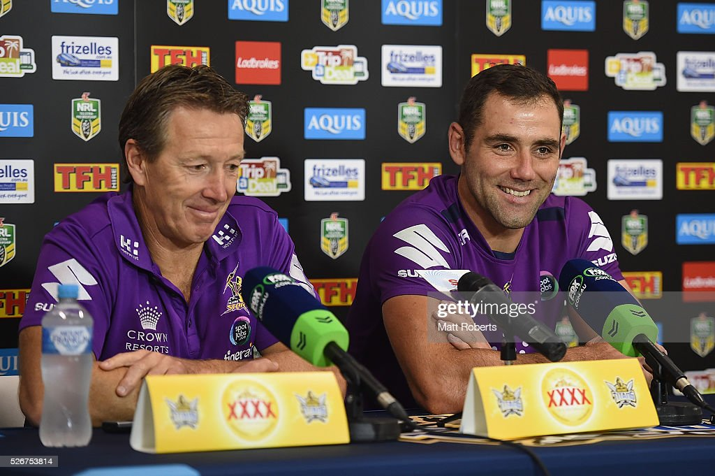 Cameron Smith of the Storm speaks during a press conference with coach Craig Bellamy after the round nine NRL match between the Gold Coast Titans and the Melbourne Storm on May 1, 2016 in Gold Coast, Australia.