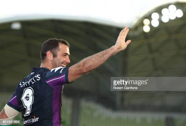 Cameron Smith of the Storm waves to the crowd after he played his 350th match during the round 21 NRL match between the Melbourne Storm and the Manly...