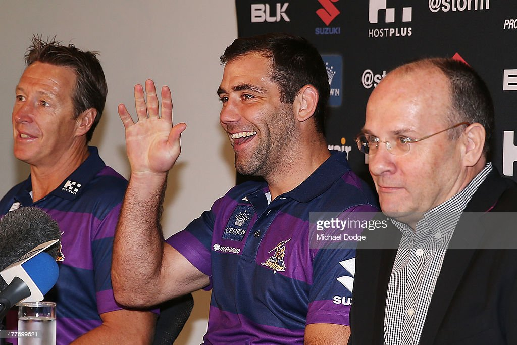 Cameron Smith of the Storm, who has signed a four year contract extension and breaks the game record for a Storm player this weekend, waves to his kids during a Melbourne Storm NRL media session at AAMI Park on March 11, 2014 in Melbourne, Australia.