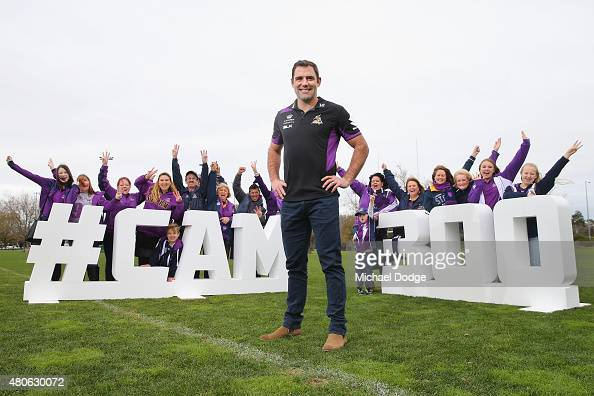 Cameron Smith of the Storm who will play his 300th game this weekend poses with his loyal fan group during a Melbourne Storm NRL media opportunity at...