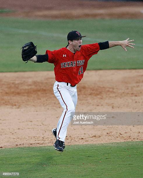 Cameron Smith of the Texas Tech Red Raiders celebrates after the final out against the Miami Hurricanes during the Coral Gables Regional at the NCAA...