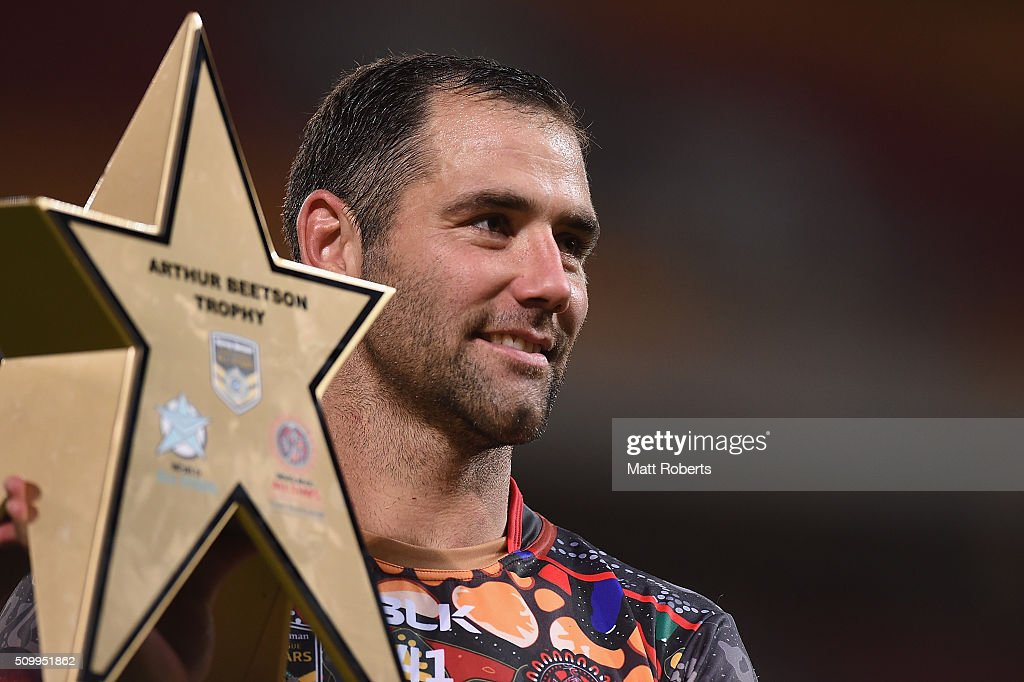 <a gi-track='captionPersonalityLinkClicked' href=/galleries/search?phrase=Cameron+Smith+-+Rugby+League+Player&family=editorial&specificpeople=453295 ng-click='$event.stopPropagation()'>Cameron Smith</a> of the World All Stars holds the Arthur Beetson trophy after the NRL match between the Indigenous All-Stars and the World All-Stars at Suncorp Stadium on February 13, 2016 in Brisbane, Australia.