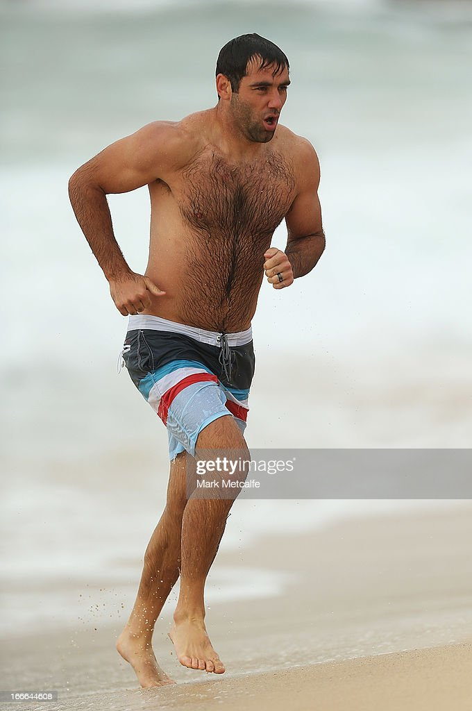 Cameron Smith runs from the ocean during an Australian Kangaroos training session at Coogee Beach on April 15, 2013 in Sydney, Australia.