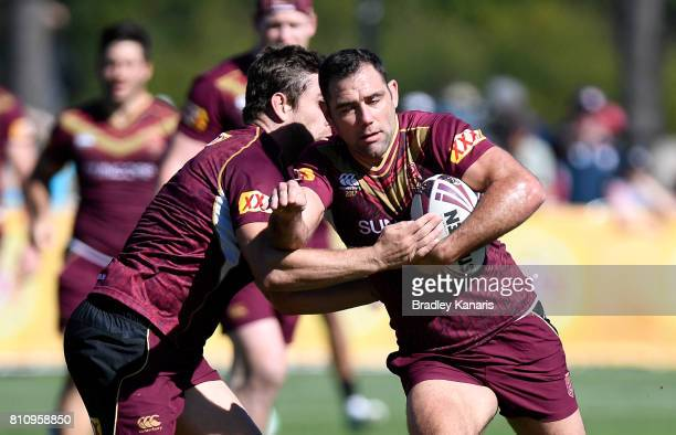 Cameron Smith takes on the defence during a Queensland Maroons State of Origin training session at Sanctuary Cove on July 9 2017 in Brisbane Australia