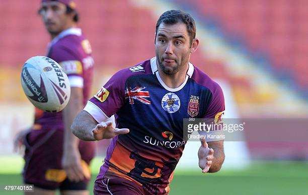Cameron Smith takes on the defence during the Queensland Maroons State of Origin captain's run at Suncorp Stadium on July 7 2015 in Brisbane Australia