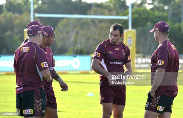 Cameron Smith talks tactics with team mate Anthony Milford during a Queensland Maroons State of Origin training session at InterContinental Sanctuary...