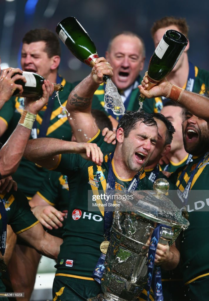 Cameron Smith the captain of Australia is soaked in champagne after his sides 342 victory during the Rugby League World Cup Final between Australia...