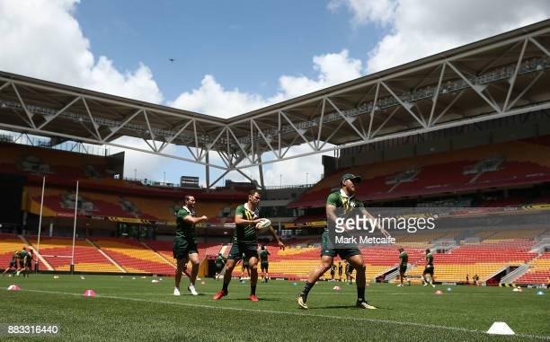 Cameron Smith Valentine Holmes and Boyd Cordner of Australia run during an Australian Kangaroos training session at Suncorp Stadium on December 1...