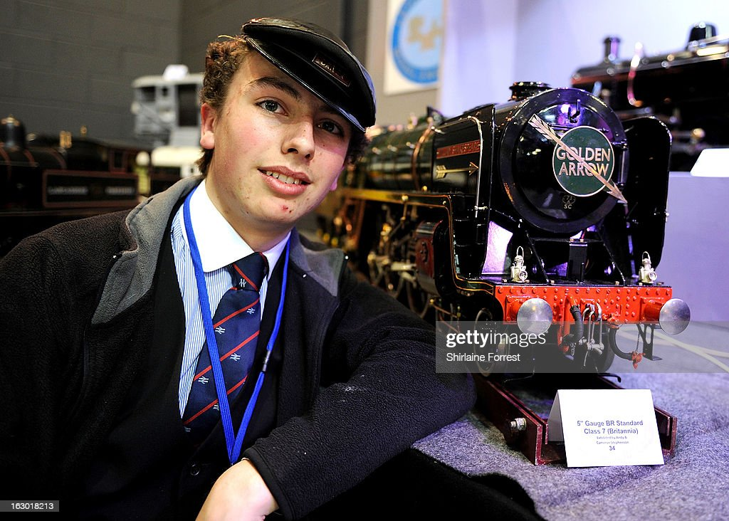 Cameron Stephenson shows the working model train built with his father Andy Stephenson in memory of his mother at the Northern Modelling Exhibition at EventCity on March 3, 2013 in Manchester, England.