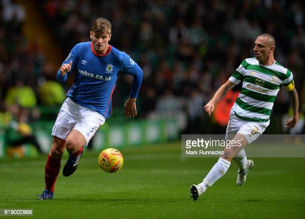 Cameron Stewart of Linfield takes on Scott Brown of Celtic during the UEFA Champions League Qualifying Second Round Second Leg match between Celtic...
