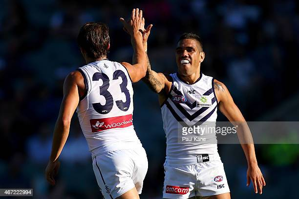 Cameron Sutcliffe and Michael Walters of the Dockers celebrate a goal during the NAB Challenge AFL match between the West Coast Eagles and the...