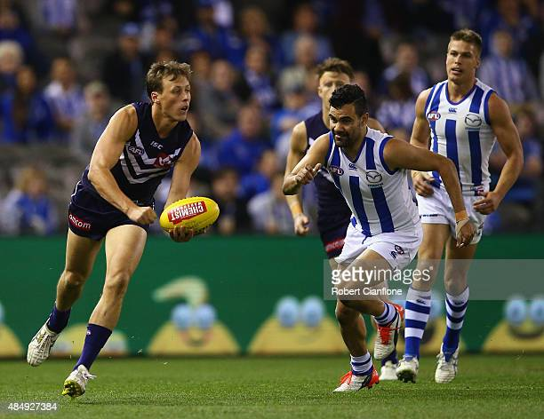 Cameron Sutcliffe of the Dockers handballs during the round 21 AFL match between the North Melbourne Kangaroos and the Fremantle Dockers at Etihad...