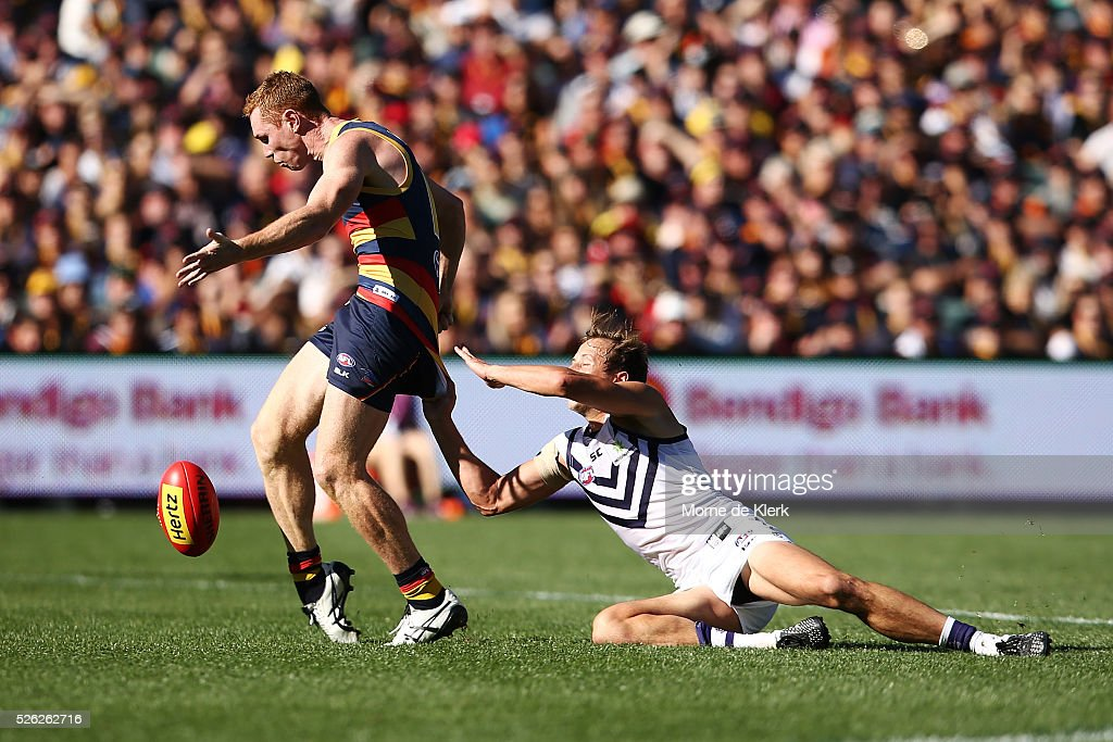 Cameron Sutcliffe of the Dockers tackles Tom Lynch of the Crows during the round six AFL match between the Adelaide Crows and the Fremantle Dockers at Adelaide Oval on April 30, 2016 in Adelaide, Australia.