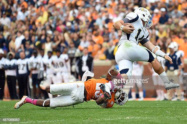 Cameron Sutton of the Tennessee Volunteers brings down Jacob Huesman of the Chattanooga Mocs during the second quarter of a game at Neyland Stadium...