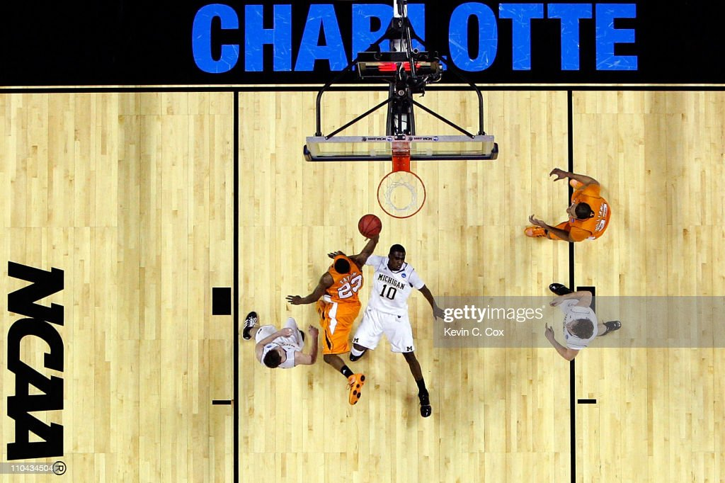 <a gi-track='captionPersonalityLinkClicked' href=/galleries/search?phrase=Cameron+Tatum&family=editorial&specificpeople=4628288 ng-click='$event.stopPropagation()'>Cameron Tatum</a> #23 of the Tennessee Volunteers goes up for a shot between Tim Hardaway Jr. #10 and Stu Douglass #1 of the Michigan Wolverines during the second round of the 2011 NCAA men's basketball tournament at Time Warner Cable Arena on March 18, 2011 in Charlotte, North Carolina.