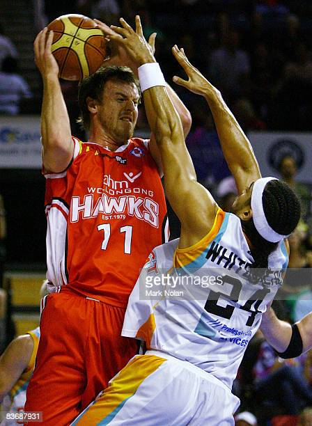 Cameron Tragardh of the Hawks is blocked by Luke Whitehead of the Blaze during the round nine NBL match between the Wollongong Hawks and the Gold...