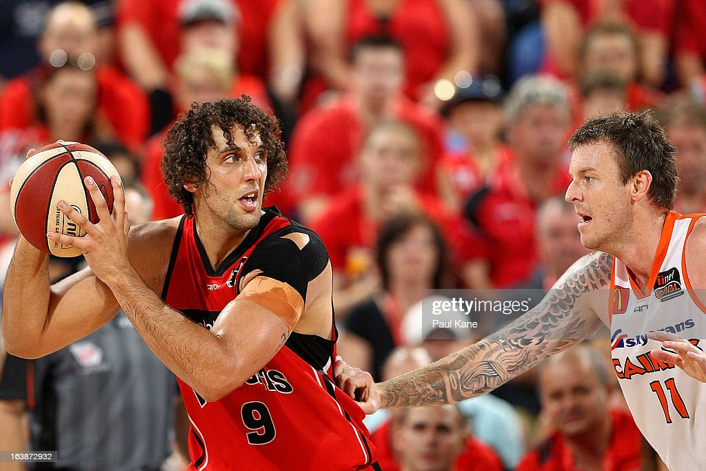 Cameron Tragardh of the Taipans holds off Matthew Knight of the Wildcats during the round 23 NBL match between the Perth Wildcats and the Cairns Taipans at Perth Arena on March 17, 2013 in Perth, Australia.