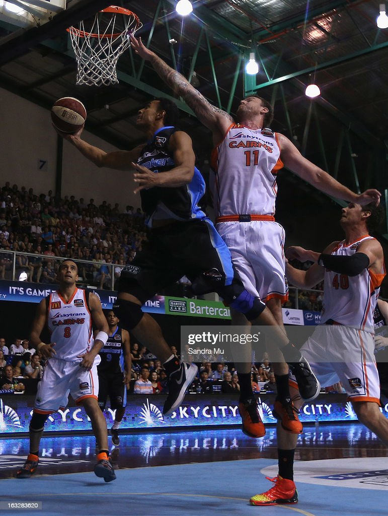 Cameron Tragardh of the Titans defends as Mika Vukona of the Breakers lays the ball up during the round 22 NBL match between the New Zealand Breakers and the Cairns Taipans at North Shore Events Centre on March 7, 2013 in Auckland, New Zealand.