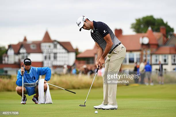 Cameron Tringale of the United States putts as his caddie looks on during a practice round prior to the start of the 143rd Open Championship at Royal...