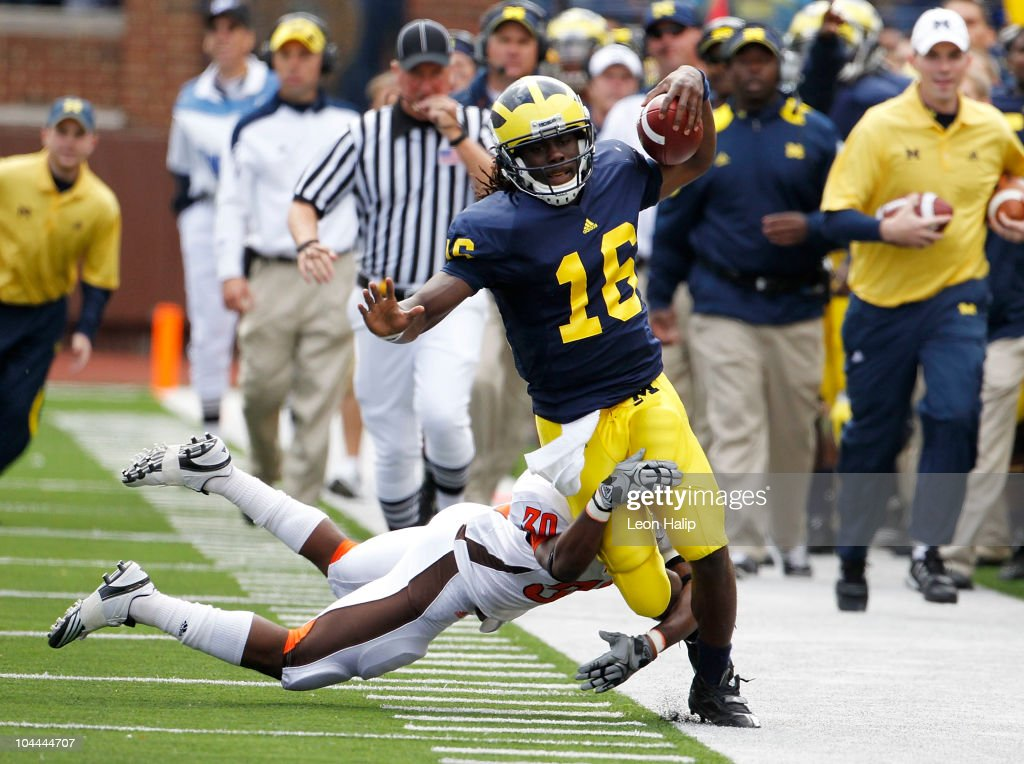 Cameron Truss of Bowling Green tackles Denard Robison of the Michigan Wolverines on September 25 2010 at Michigan Stadium in Ann Arbor Michigan...