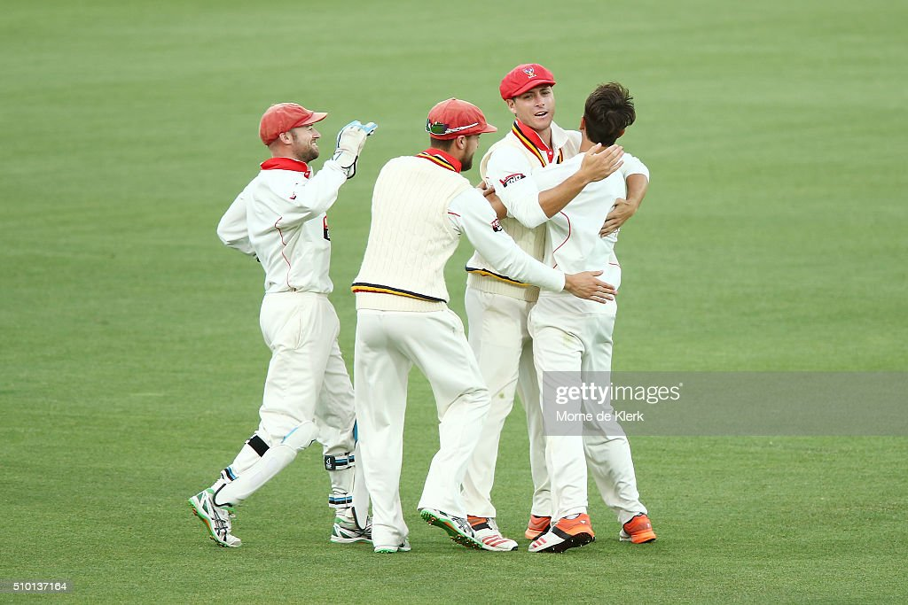 Cameron Valente of the Redbacks is congratulated by teammates after he got his first wicket, the wicket of Daniel Christian of the VIC Bushrangers, while on debut during day one of the Sheffield Shield match between South Australia and Victoria at Adelaide Oval on February 14, 2016 in Adelaide, Australia.