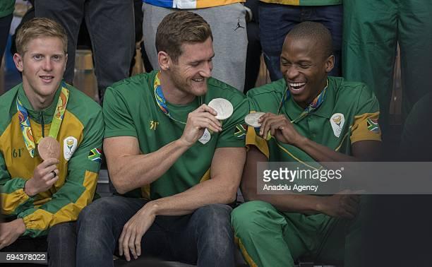 Cameron van der Burgh who won silver medal in Men's 100m breaststroke swimming Henri Schoeman who won bronze medal in Men's individual Triathlon and...