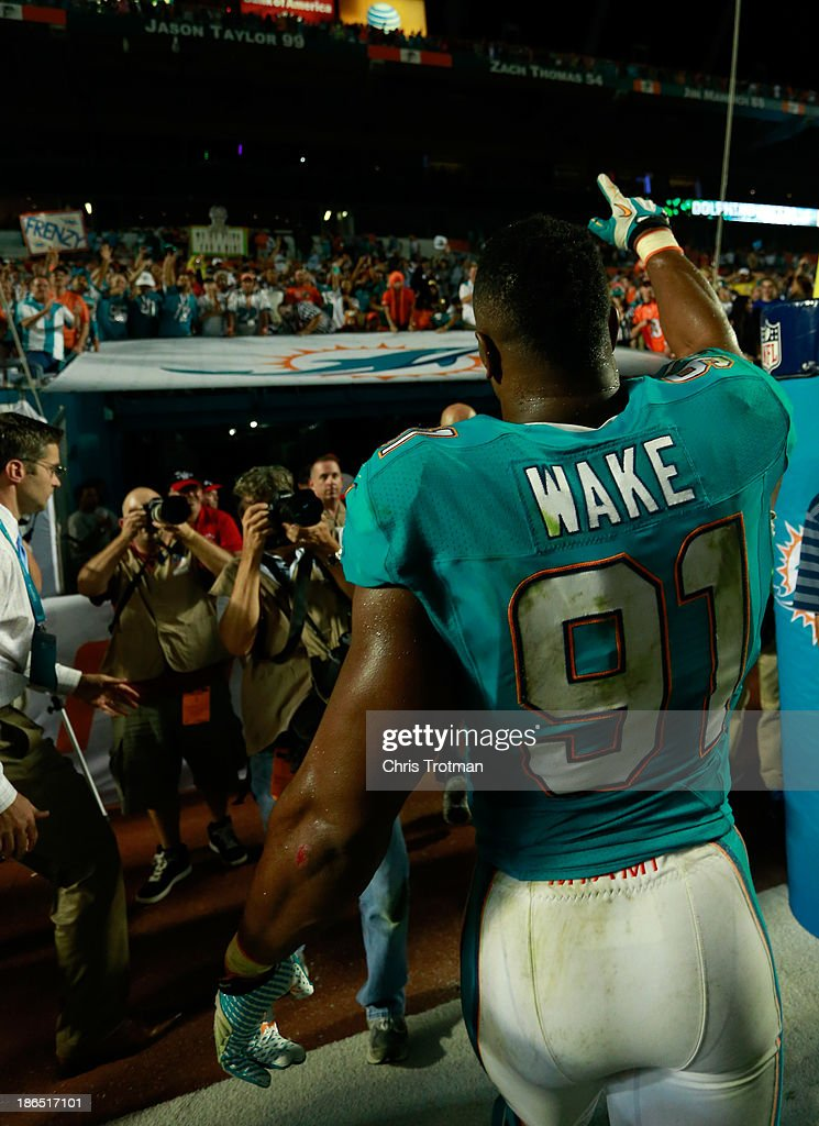 <a gi-track='captionPersonalityLinkClicked' href=/galleries/search?phrase=Cameron+Wake&family=editorial&specificpeople=2330195 ng-click='$event.stopPropagation()'>Cameron Wake</a> #91 of the Miami Dolphins acknowledges the fans following the game against the Cincinnati Bengals at Sun Life Stadium on October 31, 2013 in Miami Gardens, Florida.