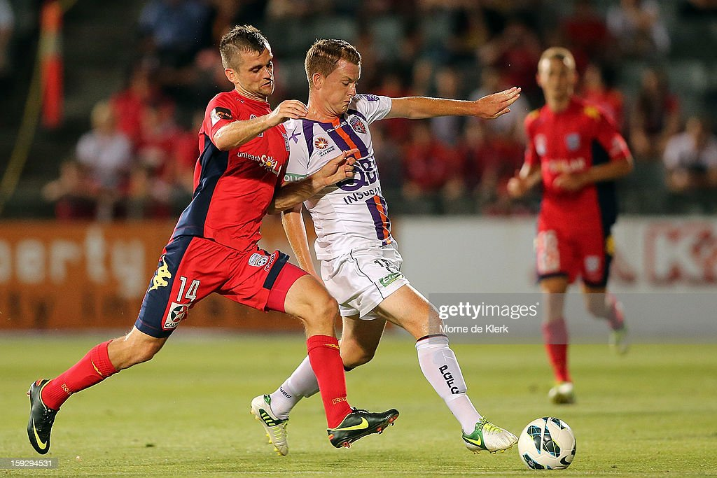 Cameron Watson of Adelaide competes with Brandon O'Neill of Perth during the round 16 A-League match between Adelaide United and the Perth Glory at Hindmarsh Stadium on January 11, 2013 in Adelaide, Australia.