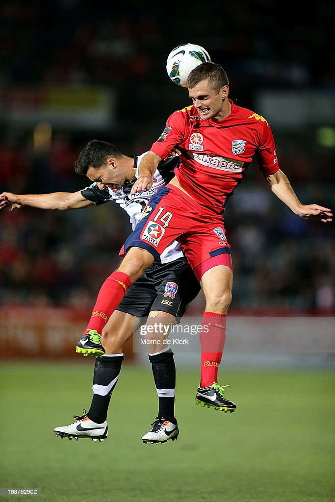 Cameron Watson of Adelaide gets up over Marko Jesic of the Jets during the round 25 A-League match between Adelaide United and the Newcastle Jets at Hindmarsh Stadium on March 15, 2013 in Adelaide, Australia.