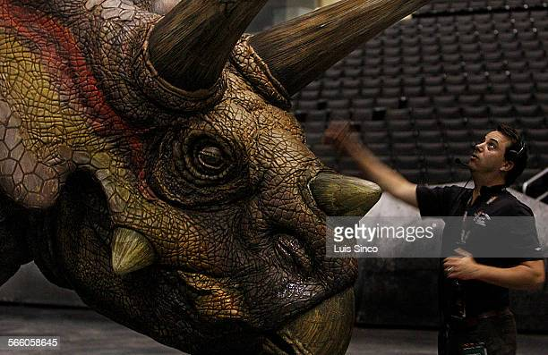 Cameron Wenn resident director of Walking With Dinosuars preps an automated triceratops before Friday's Sept 26 debut of a new theatrical production...