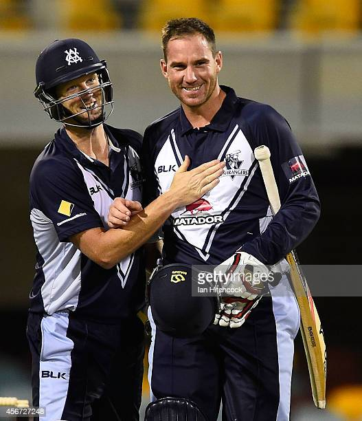 Cameron White and John Hastings celebrate after winning the Matador BBQs One Day Cup match between Victoria and South Australia at The Gabba on...
