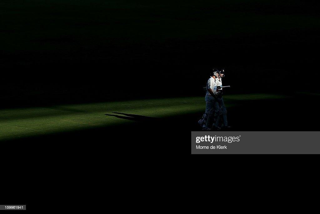 <a gi-track='captionPersonalityLinkClicked' href=/galleries/search?phrase=Cameron+White&family=editorial&specificpeople=178931 ng-click='$event.stopPropagation()'>Cameron White</a> and William Sheridan of the Bushrangers leaves the field at the end of play after day one of the Sheffield Shield match between the South Australia Redbacks and the Victoria Bushrangers at Adelaide Oval on January 24, 2013 in Adelaide, Australia.