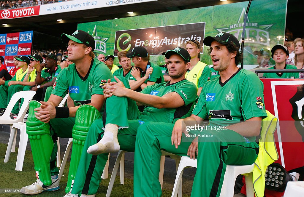 Cameron White, Clint McKay and Andy Lee look on from the players dugout during the Big Bash League match between the Melbourne Renegades and the Melbourne Stars at Etihad Stadium on December 7, 2012 in Melbourne, Australia.