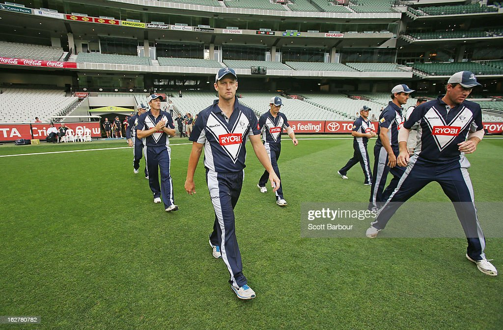 Cameron White leads the Bushrangers onto the field during the Ryobi One Day Cup final match between the Victorian Bushrangers and the Queensland Bulls at Melbourne Cricket Ground on February 27, 2013 in Melbourne, Australia.