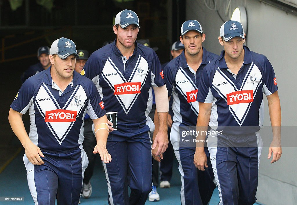 Cameron White (R) leads the Bushrangers onto the field during the Ryobi One Day Cup final match between the Victorian Bushrangers and the Queensland Bulls at Melbourne Cricket Ground on February 27, 2013 in Melbourne, Australia.