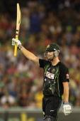Cameron White of Australia celebrates scoring his half century during game two of the International Twenty20 series between Australia and England at...