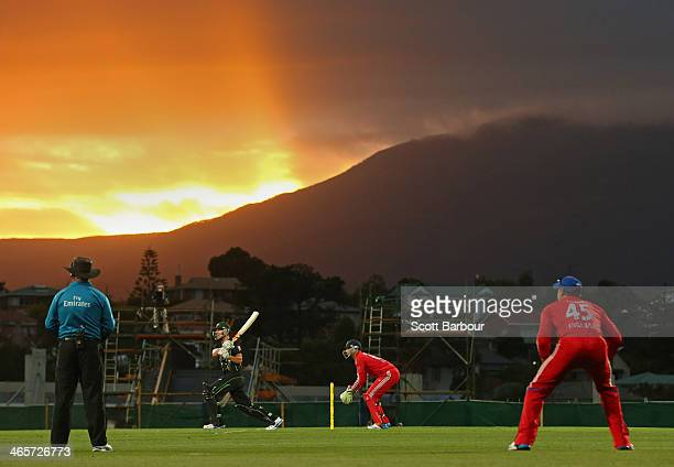 Cameron White of Australia hits a boundary during game one of the International Twenty20 series between Australia and England at Blundstone Arena on...