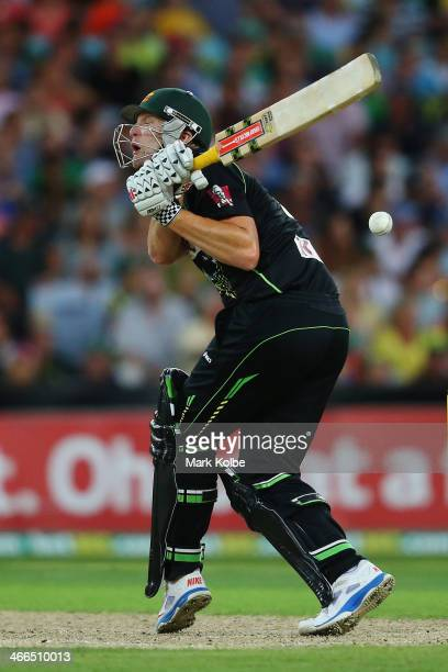 Cameron White of Australia is hit as he bats during game three of the International Twenty20 series between Australia and England at ANZ Stadium on...