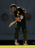 Cameron White of Australia is struck on the head by Kieron Pollard of the West Indies during the Fourth One Day International match between Australia...