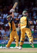 Cameron White of Australia smashes a six as Michael Hussey looks on during the ICC World Twenty20 Super Eight match between Sri Lanka and Australia...